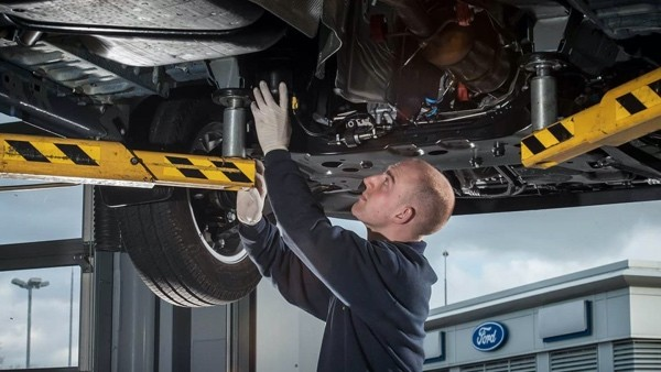 Ford Technician working on a vehicle